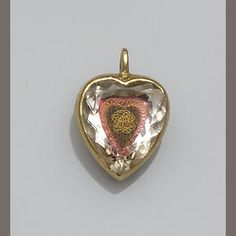 A late eighteenth-century heart-shaped pendant, 'Mounted with faceted crystal enclosing a woven hair panel applied with gilt wirework monogram, the reverse inscribed 'The Wanderer Return'd'. Enamel Jewelry, Crystal Jewelry, Antique Jewelry, Vintage Jewelry, Locket Design, Stuart Crystal, Renaissance Jewelry, Mourning Jewelry, Faceted Crystal