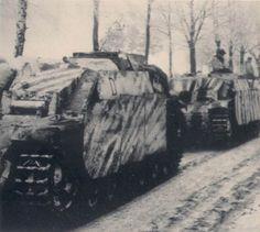 Three original photos of a column of Sturmhaubitze 42 assault guns on the move