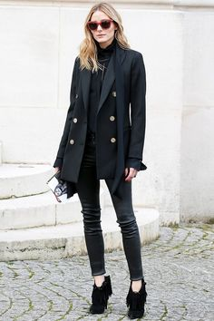 Oliva Palermo adds texture to an all black outfit with a double breasted blazer, a skinny scarf, leather pants, and fringe booties