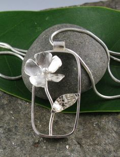 Sterling Silver Rectangular Flower Pendant by annewalkerjewelry. think of negative spaces