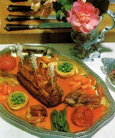 The Rack-of-Lamb Titanic surrounded by lifeboats, in a tomato juice sea.  It's going down - down the garbage disposal, that is.  From:  LILEKS (James) :: Institute :: Gallery :: French Cuisine