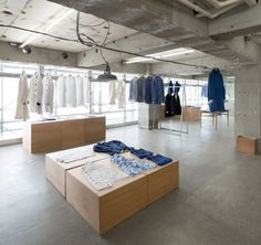 EEL Nakameguro by Schemata Architecture Office,  Higashiyama Meguro, Tokyo - the construction (stripped office back to the concrete) process was mostly subtraction, intended to leave this space somewhat incomplete and when clothes are set in place it will be complete.