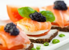 canapes with smoked salmon soft cheese eggs tomato caviar and fresh basil. concept for a tasty and healthy meal. Ideas Para Canapés, Canapes Salmon, Gourmet Recipes, Diet Recipes, Donuts, Food Cost, Low Fat Diets, Smoked Salmon, Antipasto