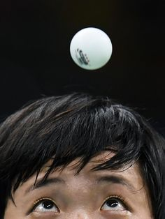 Best pictures of the week in Rio - North Korea's Kim Song I eyes the ball as she serves against Japan's Ai Fukuhara in their women's singles bronze medal table tennis match at the Riocentro venue during the Rio 2016 Olympic Games in Rio de Janeiro on August 10, 2016. / AFP PHOTO / Jim WATSON