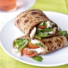 Caprese Wraps with Chicken  Turn a Caprese salad of tomato, mozzarella and basil into a sandwich by combining the salad ingredients with rotisserie chicken and wrapping up in flatbread.