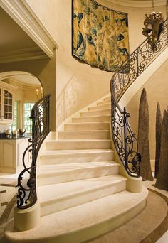 Winding marble staircase with lovely ironwork. I want my staircase to be more like this on either side. <3