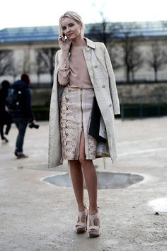Love the snakeskin skirt and trench. #PFW