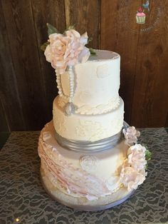 Vintage inspired wedding cake, ruffles, lace, pearls and roses all edible. By Reva Alexander-Hawk for Merci Beaucoup Cakes
