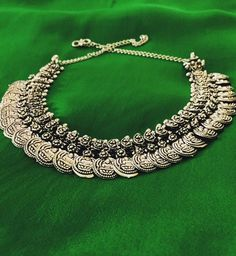We are loving this kaasu-malai-type necklace where each coin has an embossed image of Goddess of Wealth