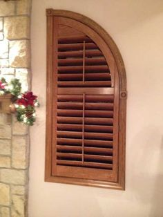 Stained Arched Shutter On Window By A Stone Fireplace By The Louver Shop.  Www.