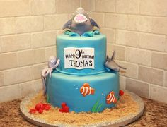 Shark cake  By: melam    Chocolate cake covered in buttercream and fondant.  URL: http://cakecentral.com/gallery/2400083/shark-cake  Read more at http://cakecentral.com/gallery/2400083/shark-cake#Sc0FZljkf1OPDjYD.99