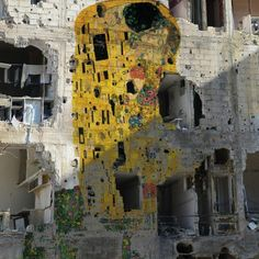 "Gustav Klimt's ""The Kiss"" on the facade of a bullet-ridden building in Damascus."