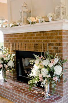 Blue and blush wedding ideas at The Bradford. Fireplace wedding decor. Photo by Caroline Lima Photography