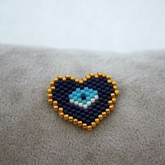 Seven hearts düşünüy I think it would be a beautiful ring 💕 You . Seed Bead Jewelry, Seed Bead Earrings, Beaded Earrings, Beaded Jewelry, Peyote Stitch Patterns, Bracelet Patterns, Beading Patterns, Beaded Banners, Evil Eye Jewelry