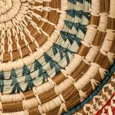 """This Checkered Pine NeedleBasket is made from pine needles and pajon, a native grass in Guatemala, with hand-dyed raffia in beautiful colors. Handmade and fair trade.  Pine needles, native grass, raffia 8 1/2""""W at top, 8"""" W at base, and 2""""H"""