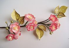 Tutorial on how to make paper cherry blossoms on a branch. So pretty!