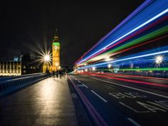 Big Ben At Night by Damien Harrow. A wonderful long exposure night time shot with light trails