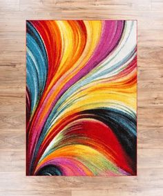 """Aurora Multi, with a sweeping brush stroke pattern, warms a cool night like the Northern Lights. Bright, multi-colored lines swirl freely across a rug equally at home in the modern living room or playroom. A plush 0.5"""" pile of air twist frieze polypropylene gives an exceptional textured look. The yarn is soft, stain resistant, and doesn't shed or fade over time. A 100% jute backing is safe for wood floors and all four sides of the rug are serged for improved durability."""