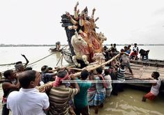 The general population who took the Durga statue through the boat for the Navartri. Location: kolkatta