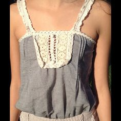 Gray Top With Crochet Accents Gray top with crochet straps and crochet chest piece, cinches at the hip. Runs small. Mine Tops