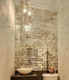 Woah! Totally want to do this... Pre-treat Mirror tiles to look like Mercury glass with alcohol, tile wall and distressed tinting... I have to find a way to put this in my house... STAT.