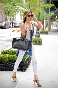 Miranda Kerr. See 49 more stars' take on the striped shirt, a style staple that like the white button-down and perfect-fit skinnies will never go out of style.