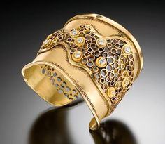 Cuff by Judith Kaufman. 22kt yellow gold, 18k green gold and diamonds.
