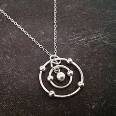 23 Majestically Beautiful Pieces Of Science Jewelry