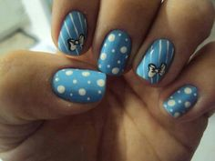 Spots and stripes pretty blue nails with little bows