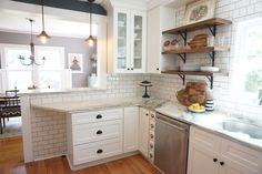 subway tiles w darker grout, shaker cabinets w/black hardware, small drawer next to dishwasher, wood open shelving- LOVE this look.