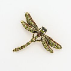 This listing is for a green dragonfly rhinestone crystals dragonfly brooch. It is great for wedding brooch bouquet, bridal dress decor, sash, ring pillow, invitations, cake and much more!  * Quantity: 1 pc * Measure : 2 1/2 W x 2 H * Stones color: green and brown rhinestone crystals * Back: pin back * Metal color: gold  Please check more brooches: http://www.etsy.com/shop/ahappywedding?ref=hdr_shop_menu§ion_id=18522001  More items in our store: http:/&#...