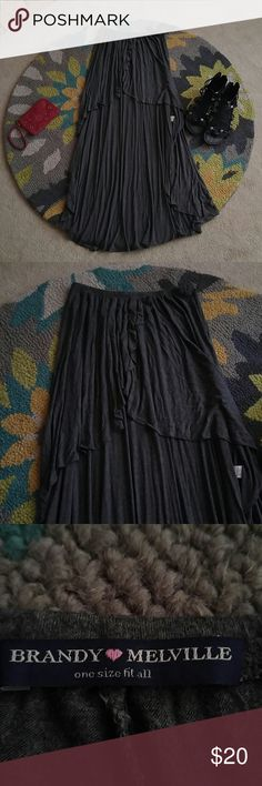Brandy Melville hi-low skirt This is a super soft gently loved and comfy skirt by Brandy Melville. One size and is short in front and longer in back. Brandy Melville Skirts High Low