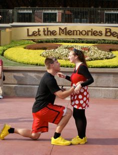 Proposal at the Entrance to Disney World.  Right through those gates at the entrance, is one of the most iconic train stations and a flower Mickey – and your future husband on one knee!