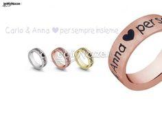 http://www.lemienozze.it/operatori-matrimonio/gioielli/fedi-per-il-matrimonio/media/foto/20  Fedi nuziali a fascia con incisione del nome