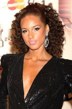 """Alicia Keys Ponytail - Alicia looked radiant at the Brit Awards where she was set to preform her hit song with Jay-Z """"Empire State Of Mind"""". She was draped in a sequin dress and diamond hoop earrings and completed her look with a bouncy curls, which were pulled back in a high ponytail."""