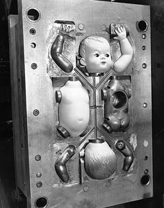 Parts of a doll in an injection mould at Cascelloid's factory at Leicester Original Publication Picture Post 5617 Toys Are Big Business pub 1951