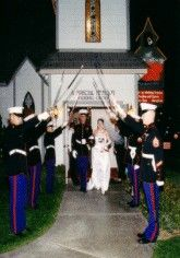 Military wedding protocol.the last Marine taps the Bride in the butt  as she goes through!  cool huh!