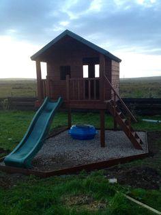 Handmade kids outdoor playhouse with slide