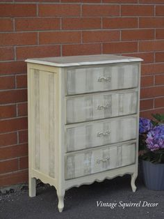 French Provincial Dresser painted in Annie Sloan Cream, Versailles and Old White chalk paint.  Accented with gold gilding wax.