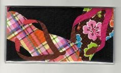 "Big Colorful Flip Flop on Black Checkbook Cover by Tickled Pink Boutique. $5.99. The sturdy clear VINYL COVER encases a fabric bonded design. Measuring 6 1/4"" x 3 1/4"",  the cover fits all standard bank checkbooks and banking registers.  All checkbook covers come with a register flap and a duplicate check flap  just like the bank, only flashier.  These checkbook covers are a great alternative to the expensive covers offered by banks and online check companies."