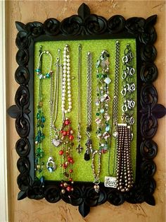 Fabric wrapped cork board in a frame. I always need more necklace organizers.  I can make this!!