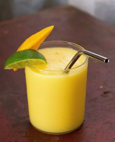 Mango Colada // 1/2 c fresh juiced mango juice, 1/2 c fresh mango cubes, 1/2 c crushed ice, 1/4 c coconut milk, 1 T lime juice, 1/2 c white rum (optional) - YUM
