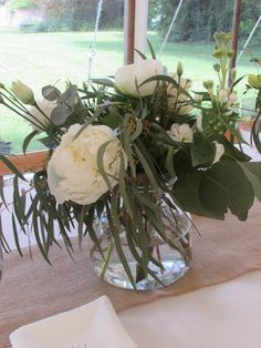 vase of flowers for tables using peonies, roses, lisianthus and lots of flowing eucalyptus foliage