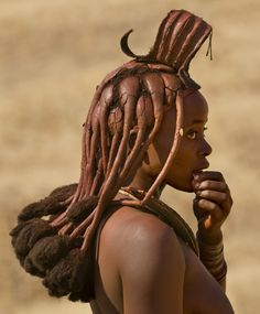 Himba nation, Africa. Beautiful woman with red skin.