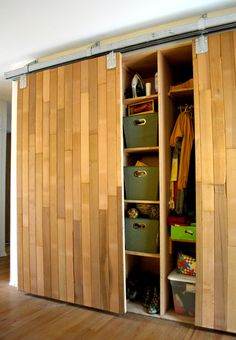 Barndoor made from reclaimed lumber.  Could build this from pallet wood...
