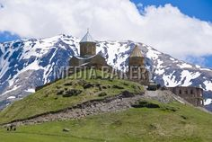 This is a Media Bakery licensable image titled 'Famous Tsminda Sameba church, Kazbegi, Georgia, Caucasus, Central Asia, Asia' by artist Michael Runkel for editorial and commercial use only. No use with out payment. Search our large selection of royalty free and rights managed stock photos.