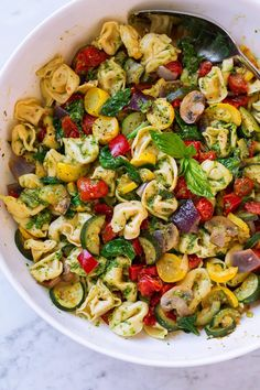 Tortellini with Pesto and Roasted Vegetables - A great way to eat lots of veggies at once! Store bought four cheese tortellini is tossed with bright flavorful pesto and a variety of colorful roasted veggies. A delicious, easy dinner you'll want to make again and again! Preferably boil tortellini during last 7 minutes of veggies roasting so they'll both finish and be warm at the same time. #summerrecipe #vegetables #roastedvegetables #tortellini #pesto #pasta #dinner Cheese Tortellini Recipes, Pesto Tortellini, Chicken Tortellini, Pesto Pasta, Pasta Recipes, Cooking Recipes, Pesto Chicken, Keto Recipes, Ricotta Gnocchi