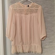 H&M Creme blouse H&M Creme blouse. Size 10. Elastic in waist and three-quarter length sleeves. Four button detail on back neck. Fits small. Open to best offers, but please submit an offer. I prefer not to negotiate in the comments section. No trades please. H&M Tops Blouses