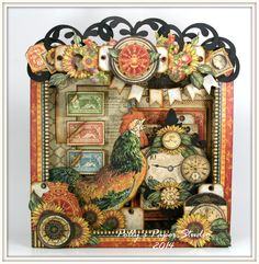 Shadow box with lots of layers by Ginny at Polly's Paper Studio. I love the topper that she made on this.