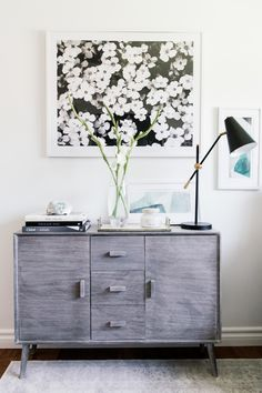 midcentury modern console table in grey wood // floral artwork // black arm lamp // neutral office decor